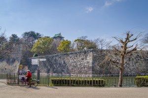 Cyclist at Osaka Castle - Osaka, Japan